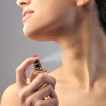 woman sprays perfume