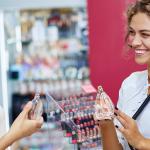 two women choosing perfume in the shop